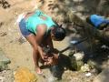 Uso multiple de fuente de agua en Queimados